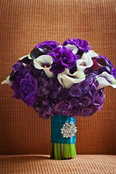 pretty purple bouquet with teal ribbon. Maybe less purple!