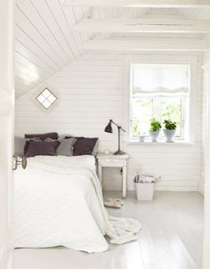 Love so much about this. White boards, white bedding, green plants and a cute little diamond window.