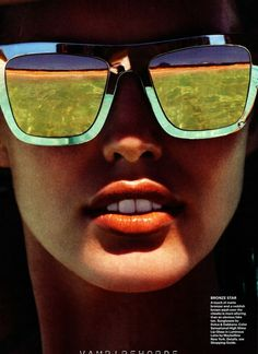 Reflective shades and a tangerine lip.