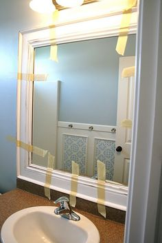 BATHROOM MIRROR MAKEOVER. This is something easy you can do to dress up a rental.. I would hang it differently so it's easy to remove if need be.