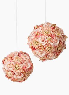 These faux flower balls have pink colored roses and hydrangeas, and come on a fishing line loop so you can hang it for your decor at a wedding ceremony or party. Or try them sitting on an urn or bowl for a table centerpiece.
