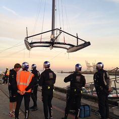 #OracleTeamUSA sailors watch the AC72 being pulled out of the water at sunset. #thingofbeauty