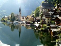 Hallstatt in Austria is a photographers dream and has to be most of one pf the most beautiful scenic villages in Europe, if not the World. Hallstatt is a village in Austria's mountainous Salzkammergut region. Oh The Places You'll Go, Places To Travel, Travel Destinations, Places To Visit, Holiday Destinations, Hallstatt Austria, Salzburg Austria, Dream Vacations, Vacation Spots