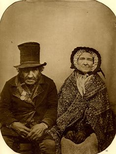 Veteran of Waterloo with his wife, 1850. This photo was taken 35 years after the battle. There is no info as to the nationality of the veteran. The attire gives no real clues. One thing's for sure: there were no veteran's benefits for this couple judging from their rather scruffy overall appearance. .