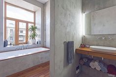 The bathroom is such a clean space. Metal meets metal meets wood -- Unusual Layout Defining a 58 Sqm Open Studio Apartment in Ukraine