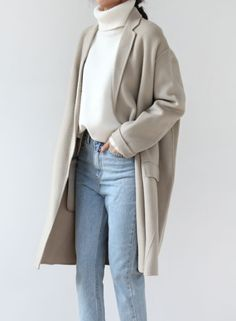 Dull texture, the colors are really muted and the fabrics are soft and appear more dull because they aren't shiny or exciting. The sweater has a turtleneck neckline
