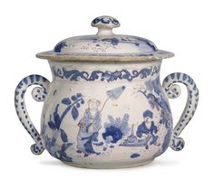 AN ENGLISH DELFT CHINOISERIE TWO-HANDLED CUP AND A COVER CIRCA 1690, PROBABLY LONDON OR BRISTOL 'Trekked' in manganese and painted in blue with Chinoiserie figures in a continuous landscape