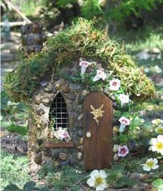 Little fairy house. Love the stone and moss.