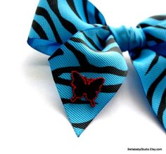 Turquoise Blue Zebra Print Hair Bow Butterfly by BELLABABYSTUDIO, $5.00. Could we get without the butterfly?
