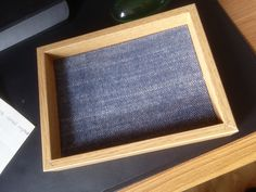ikea picture frame, back covered with cloth and then a tablet screen protector put over a picture on the the other side so can be used as a regular photo frame when not being used for play.