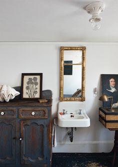 Vintage Bathroom with Gold Mirror