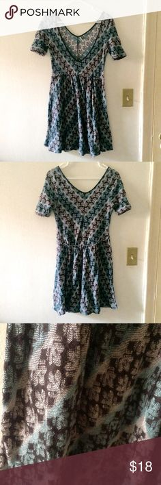 Free People Chevron Patterned Tunic Dress Free People dress with a fun blue and grey overall chevron pattern. Garment was marketed as a tunic but falls more like a dress unless you're very busty. Marked size M, fits true to size. Good used condition. Free People Dresses