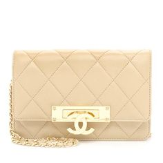 Classic yet unmistakably modern, this Chanel Wallet on a Chain (WOC) is a highly-coveted style from the 2014 Cruise Collection. The bag features a quilted dark beige leather exterior, finished with shiny gold-tone hardware. An iconic CC fold-over clasp opens the front flap, while woven leather handles provide a chic finish.