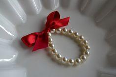 Little Girl Pearl Bracelet with ribbon for flower girl gift, birthday gift, baby or girls photo prop. $8.95, via Etsy.