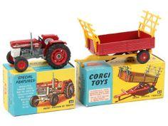 CORGI TOYS (GB) 66 MASSEY FERGUSON 165 Tracteur agricole rouge & gris A.b pneus légèrement salis - un manque de papier sur un rabat de boîte - on y joint une remorque basculante fourragère de la marque (référence 62) en état 'A'-'b' (un petit manque de papier sur un rabat) 95€ Massey Ferguson, Corgi Toys, Wooden Toys, Gray, Tractor, Paper, Tractors, Wooden Toy Plans, Wood Toys