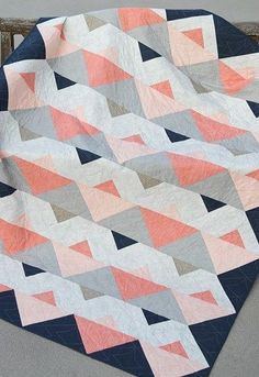 Earlier this year I had a quilt pattern published in Issue 44 of Love Patchwork & Quilting. I'm excited that this pattern has come home again to Bonjour Quilts. The design is called Triangle Twist a