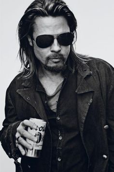 Brad Pitt drinkin' a Coors, probly listenin' ta the Allman Brothers, Whipping Post, with the Camaro parked in the yard.
