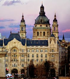 Stephen Basilica with the Gresham Palace in the front - Budapest, Hungary Beautiful Buildings, Beautiful Places, Places Around The World, Around The Worlds, Capital Of Hungary, Budapest Hungary, Visit Budapest, Heart Of Europe, Cruise Destinations
