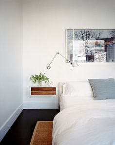 Black floors, floating nightstand. Photo from Lonny Magazine