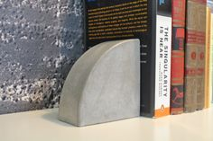 Not vintage, but very cool.    Concrete Bookends. $45.00, via Etsy.