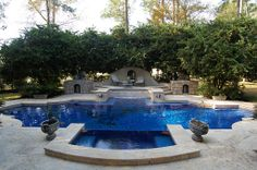 Winkler Ivy Pond House: Award winning pool with glass tile surface Swimming Pools Backyard, Swimming Pool Designs, Raised Deck, The Woodlands Tx, Pool Fountain, View Photos, Pond, New Homes, Patio
