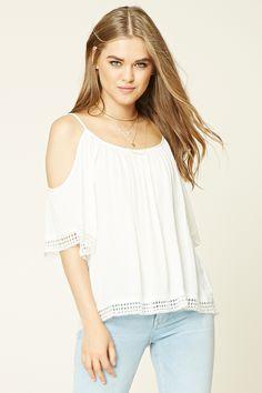A woven gauze top featuring an open-shoulder design, short sleeves with crochet trim, and a crochet hem.