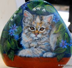 This is where you will find samples of my art work. Custom painted rocks, pet memorial stones, painted saw blades, commissions and more can be purchased here