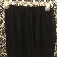 High Low Skirt High Low Pleated Skirt Black Semi Sheer. (pictured) Size XSmall Xhilaration Bought, thinking itd be fine as an XS, but nope lol.  Wore to try on. Xhilaration Skirts High Low