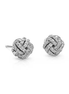 Simply elegant, these diamond love knot stud earrings feature round pave-set…