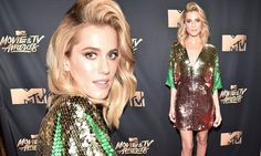 Allison Williams looked every inch the stunning star when she attended the MTV Movie & TV Awards in LA on Sunday, wearing a green, gold and pink sequinned shift dress.