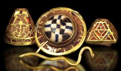 A large hoard of rare jeweled gold and silver artifacts was recently discovered in July of 2009, in field near Lichfield, Staffordshire using metal detector scans. A total of over 1,500 pieces of Anglo-Saxon metalwork were eventually recovered from the site, including several exquisite examples of garnet-inlaid goldwork formed as snakes, birds, horses and other animals.