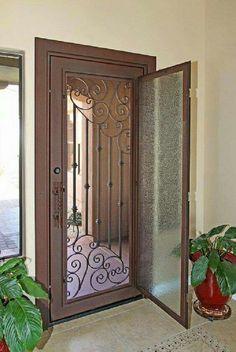 Glass door opens to expose wrought iron security door to allow fresh air in House Design, Iron Door Design, Security Door, Door Gate Design, Window Grill Design, House Doors, Doors Interior, Iron Entry Doors, Front Door Design