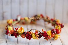 An unique Autumn Woodland flower crown in dark red and orange, with orange and red berries and cute small mushrooms. Its perfect for Autumn