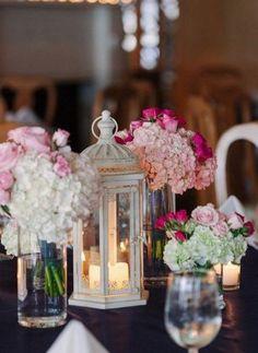 pink flowers and vintage lantern wedding reception centerpiece idea via kk photography
