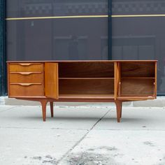 This classically styled mid century sideboard/credenza is the piece your home needs! With ample storage space, 3 drawers for all your lose nick knacks and even a drop down mini bar, you'll be ...