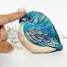 The Bird Stone, I love special natural form of stone,when I see it in the first time,I think to Little Bird,then I start to drawn her,The lovely Little Bird. Thank you.