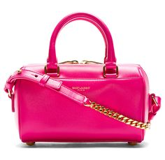 Fuchsia Leather Toy Duffle Bag by Saint Laurent. Buffed leather toy duffle bag in fuchsia pink. Gold-tone hardware. Rolled carry handles. Removable adjustable curb chain shoulder strap. Gold logo stamp at front face. Two-way zip closure at main compartment. http://zocko.it/LDCCL