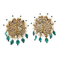 A Pair of Antique Diamond and Emerald Earrings  North India  19th Century    A pair of large diamond earrings in the form of peacocks mounted with basra pearls and colombian drop emeralds.The reverse has bold enamel decoration in the form of a peacock