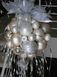 Hot glue ornaments to a foam ball~ hang over table, entry way, etc.
