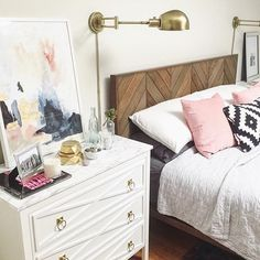 @onelessonatatime spray-painted gold knobs, added overlays, covered the top with marble contact paper and voila! A gorgeous new nightstand. Besides that the headboard totally rocks.  : @onelessonatatime