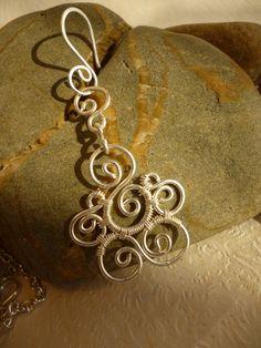 Spiral earrings wire jewelry. $18.00, via Etsy.