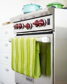 No-Slip Dish Towels- simply add a strip of Velcro to end the towel-on-the-floor madness. Via Martha Stewart Home & Garden