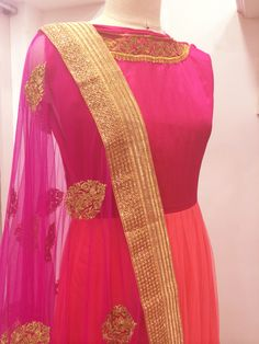 Pretty-in-pink bridal anarkali embroidered with gold motifs on raw silk , matched with a tulle dupatta.