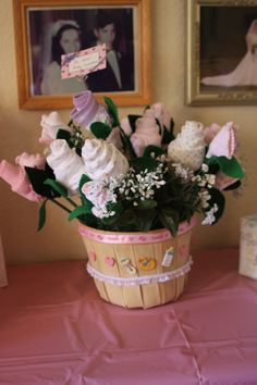 Baby shower bouquet, made of baby socks and washcloths.