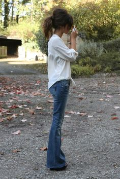 Low-rise flare jeans, clean blouse, and high pony!