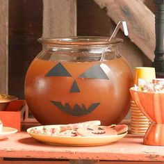 DIY Halloween Punch Bowl...from a large fish bowl is so cute! Kids Carnival Halloween Party Ideas on this site.