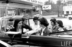 Catholic High School teenage girls having fun at the Drive-In, in a 1956 Ford Black Sunliner Convertible on the Cover of Life Magazine.