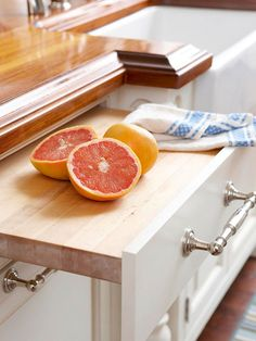 "Cutting Board Convenience ""Ensure a cutting board is always within reach by incorporating a pullout version into your kitchen cabinetry. For added convenience, store knives in a drawer directly below the cutting board. This pullout is located next to the sink, which makes cleanup a breeze."""