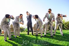 Funny moment with groomsmen shotgunning at beer! Ritz Carlton Laguna Niguel Wedding | Maria Lindsay Weddings | grey and mint green suits | Jim Kennedy Photographers
