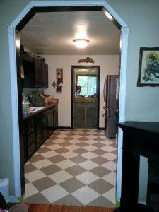 Painted Hardwood Floors are an inexpensive way to bring new life to your old beat up hardwood floors. This easy process changed the look of our kitchen!